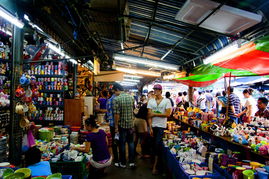 Shoppers browse colourful stalls at Chatuchak Weekend Market