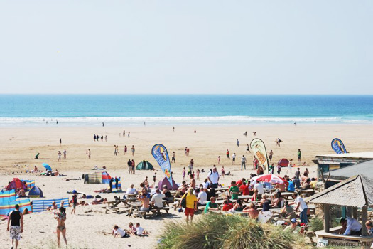 A surfer's paradise at Perranporth Beach, Cornwall. Photo by The Watering Hole