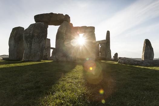 Sun rises behind Stonehenge