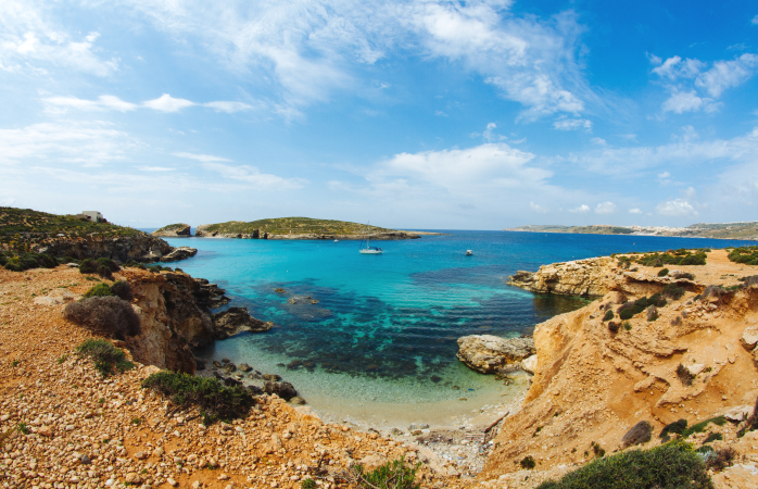 A panoramic view of Comino's unspoilt coastline and clear sea waters.