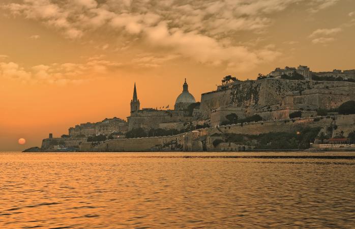 The sun goes down over Malta's beautiful capital city.