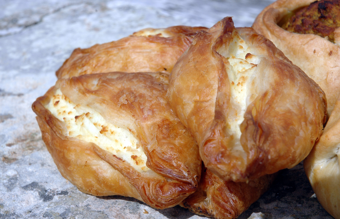 The delightfully flaky Pastizzi pastry, stuffed with fresh cheese.