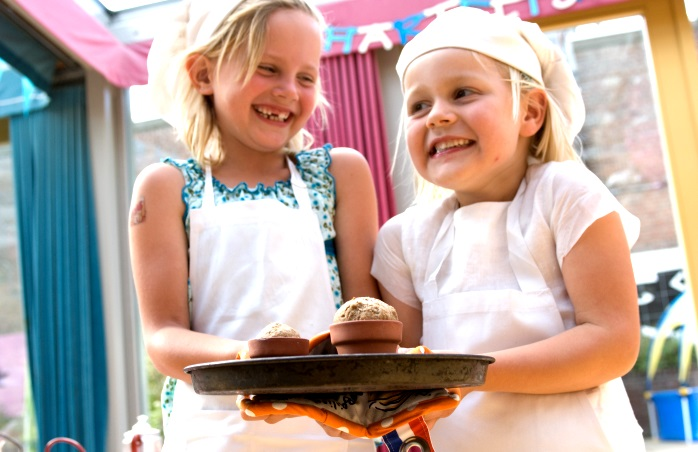 Two young cooks having fun at the Kinderkookkafe.