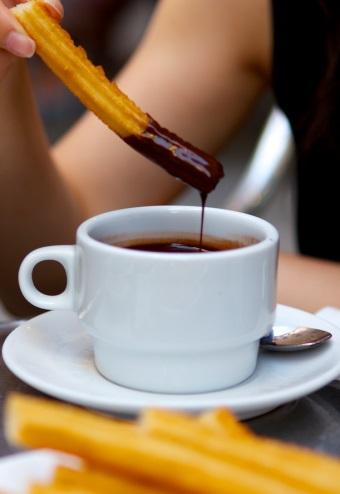 A crispy churro dunked in hot chocolate.