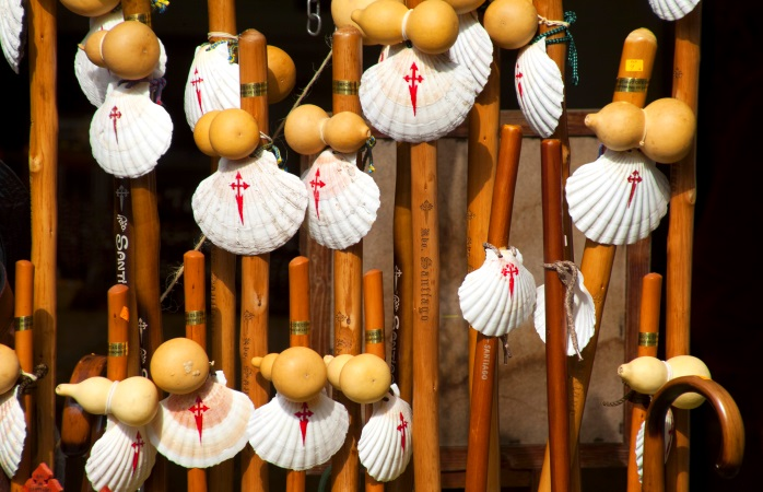 Pilgrim walking sticks adorned with Galician scallop shells bearing the cross of St. James.