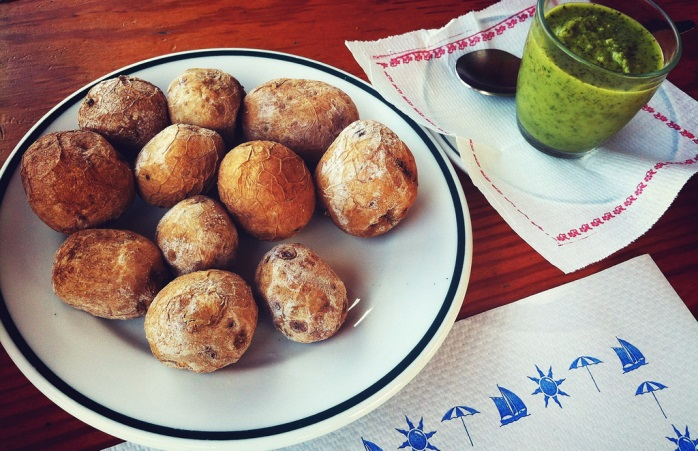 Traditional papas arrugadas and mojo verde from the Canary Islands.
