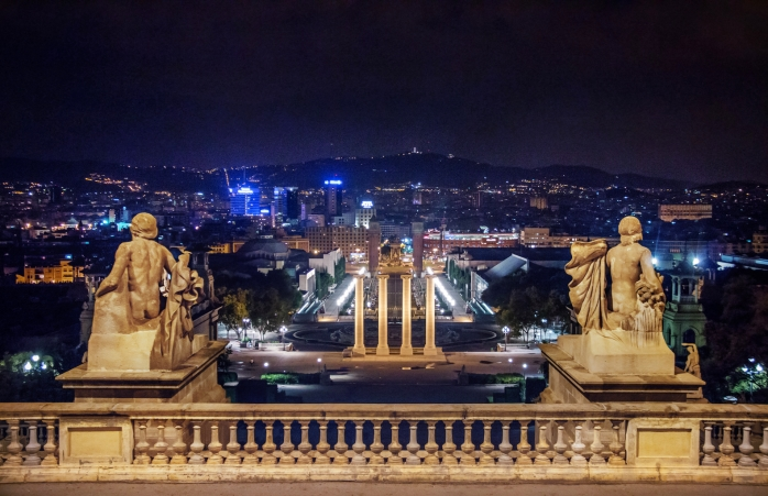 The national palace in the Montjuic hill lights up the night sky.