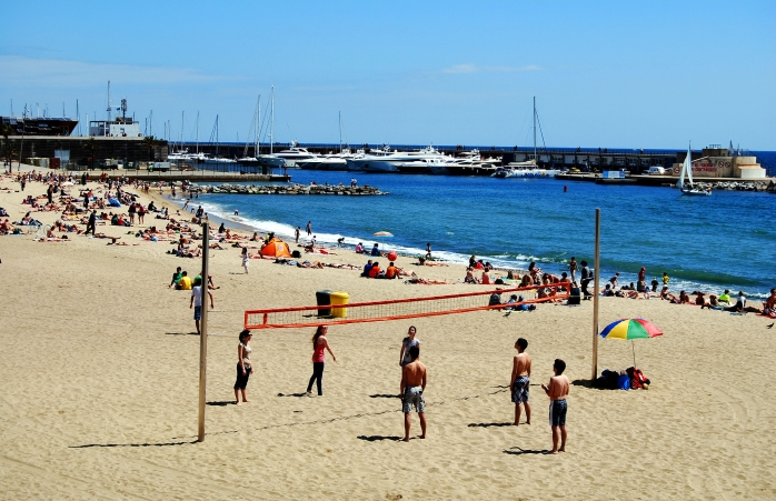 A beach volleyball game in Barcelona.