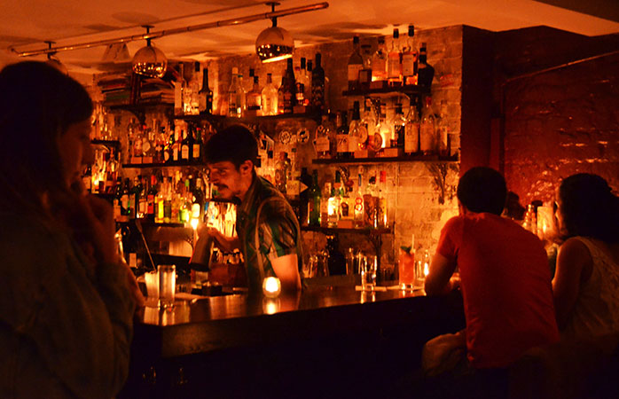 The warm, inviting glow of Happiness Forgets, one of the best cocktail bars in London.