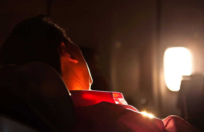 Reduce your jet lag symptoms by adjusting your body clock and getting some shut eye.