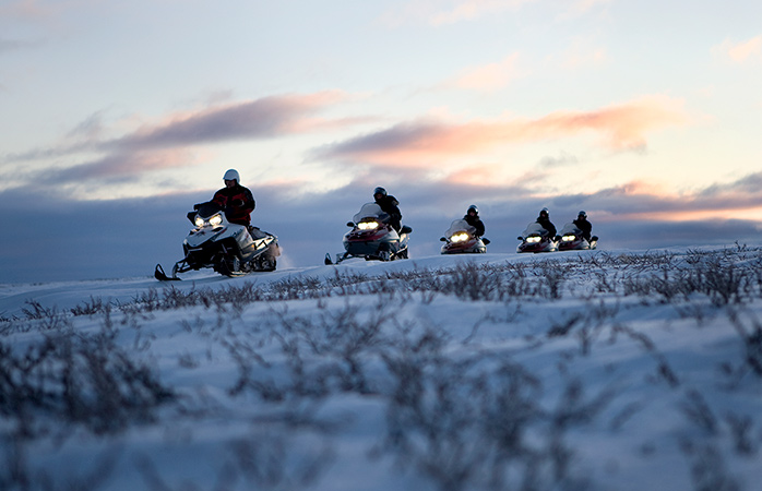 Snowmobiling across the Finnmark Plateau.