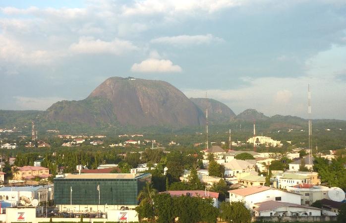 Nigeria's huge monolith, the Aso Rock, kissing the Abuja skyline.