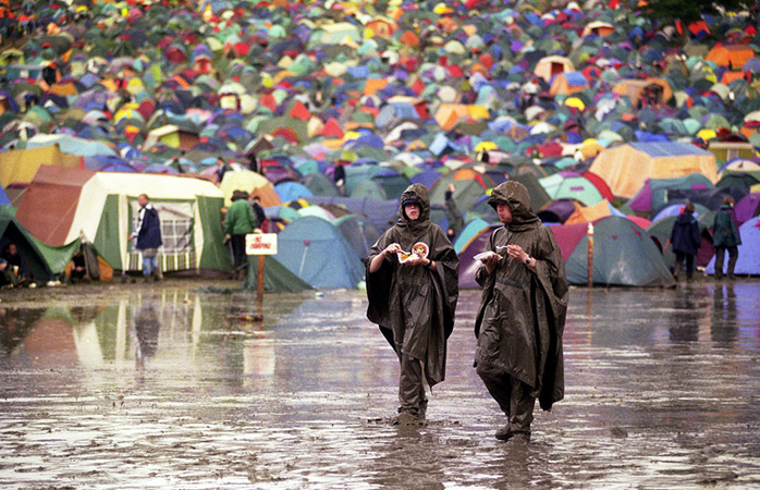 Follow the festival pros - say no to an umbrella, and embrace the rain coat