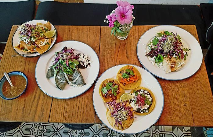 A table full of delicious Café Chilango tacos