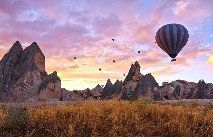 Start the day with a hot air balloon ride over Cappadocia