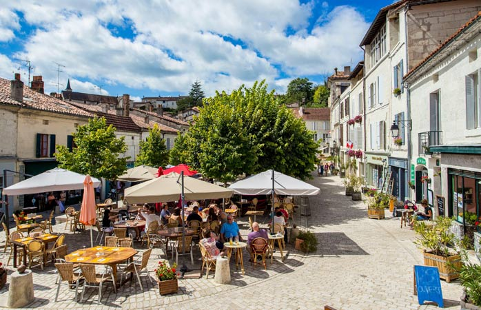Have a glass of Cognac at Aubeterre-sur-Dronne, one of the most beautiful villages of France