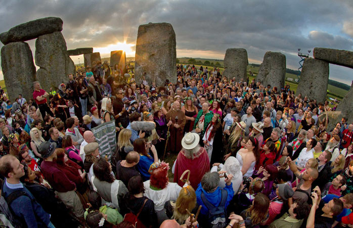 Druids and pagans celebrating the Summer solstice at Stonehenge