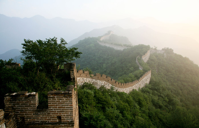 A view of the morning mist revealing the Jiankou portion of the Great Wall near Mutianyu