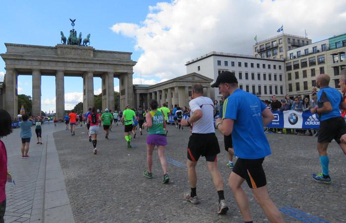 Running through Berlin's history, past Brandenburg Gate