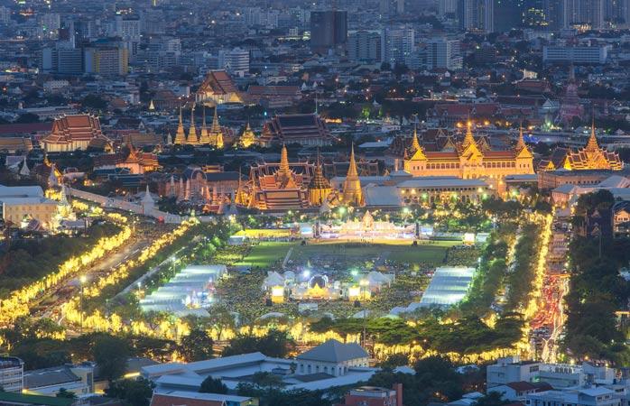 Run Bangkok by night past the Grand Palace all lit up