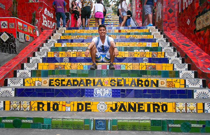 Manuel relaxing on the world famous Escadaria Selarón steps of Rio de Janeiro, Brazil