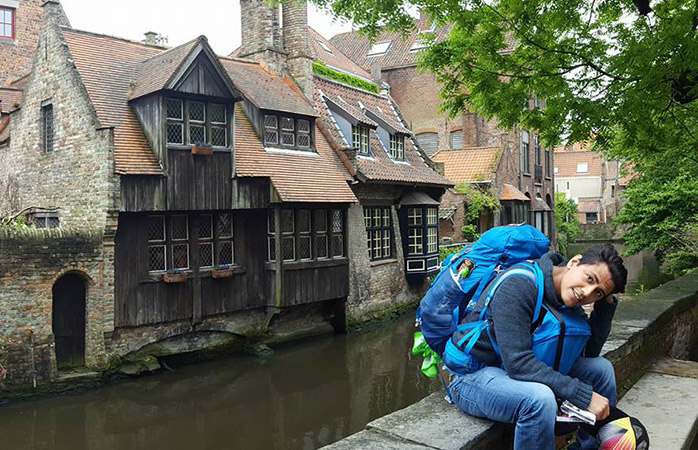 Manuel relaxing by the canal in Bruges
