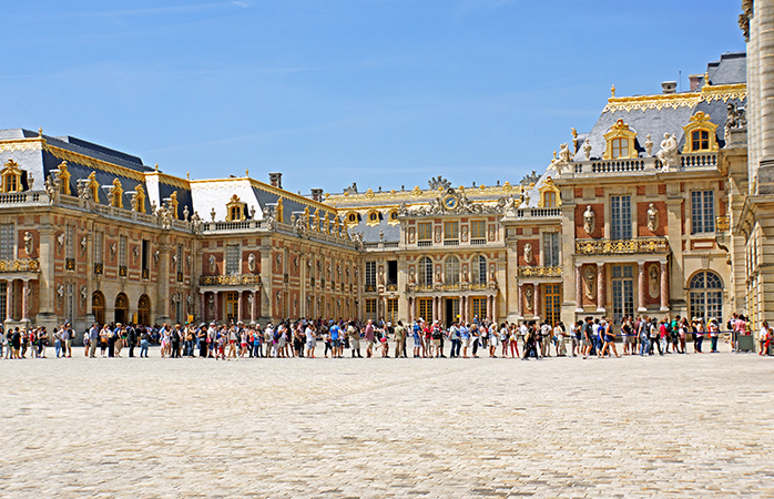 Sunny queuing outside the Palace of Versailles
