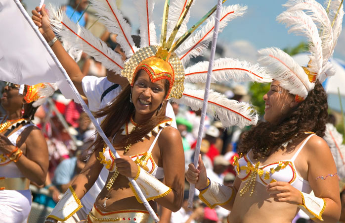 Feathers and glitter acquired, follow the Caribana Festival Parade
