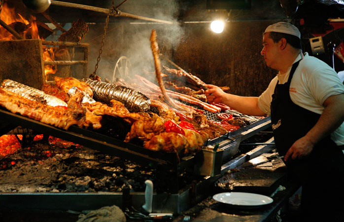 Can you hear the sizzle? Meats cooking on the parrilla at the Mercado del Puerto
