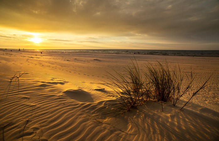 A sight to behold: sunset at the beach in Słowiński National Park