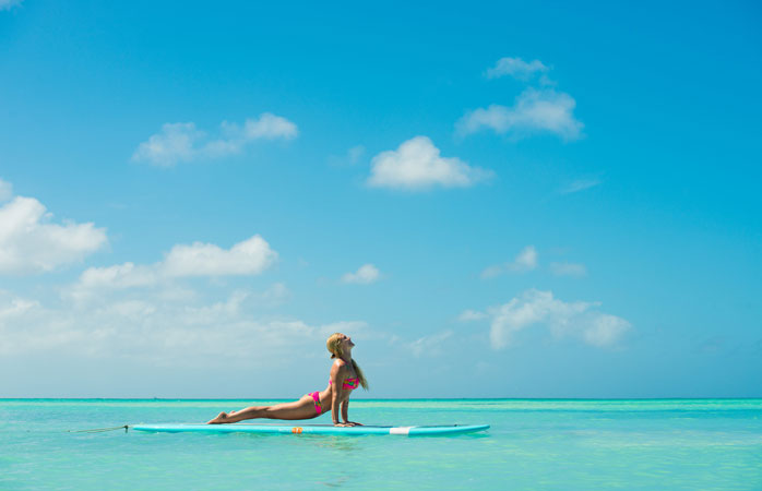 Try your hand at SUP Yoga at Rachel Brathen's Island Yoga Retreat