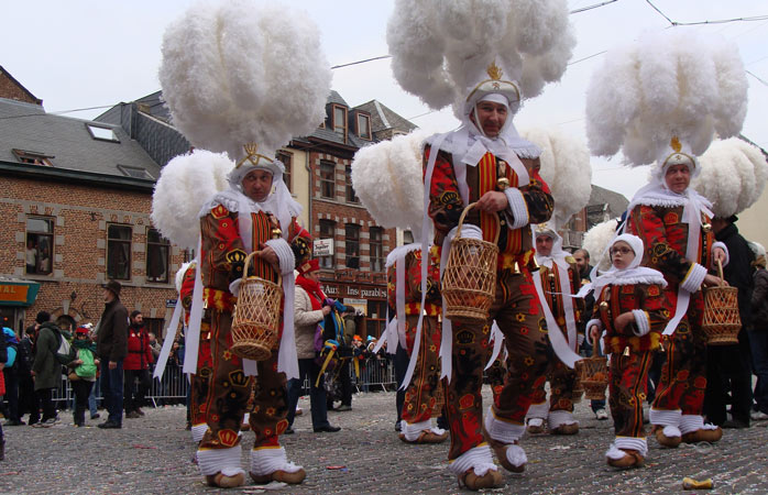 Weird and wonderful costumes galore - the Carnival of Binche offers plenty of amusement for carnival goers