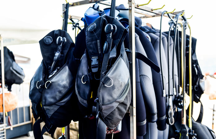Scuba gear might be nice to have, but give it a couple of dives before you purchase it all