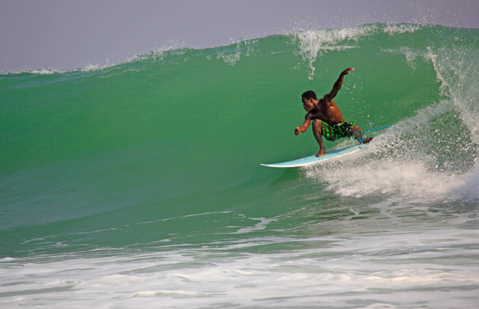 On days like these, the local surfers of Busua come out to play © Ahanta Waves Surf School & Camp