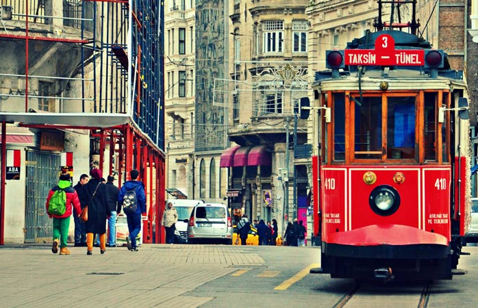 Istanbul's iconic tram makes its way through the streets in Taksim