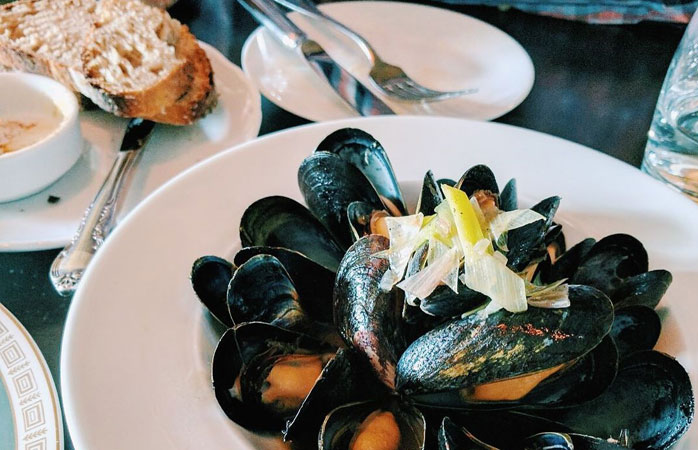 Mussels smoked in pine needles at Boralia on the Ossington strip