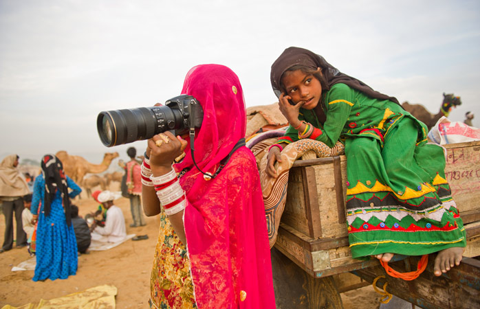 Ami teaching Subita and her sister how to use the camera