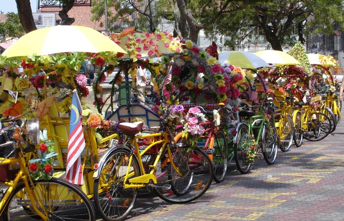 Hop in one of these colourful rides and let Malacca unveil itself to you