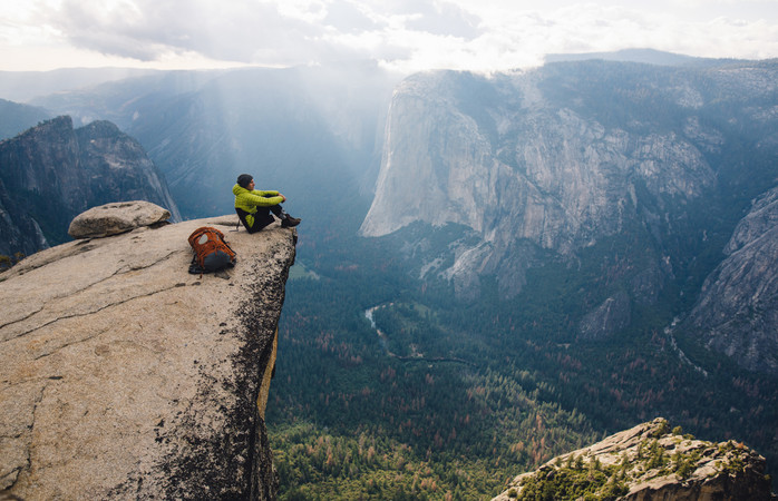 A traveller overlooks Yosemite National Park, California