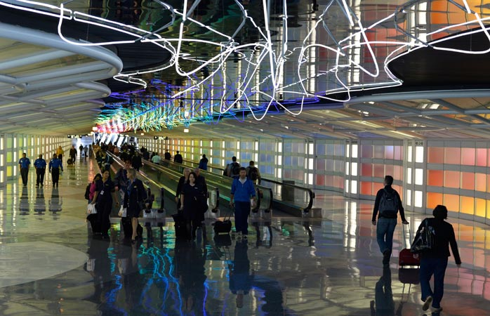 """The """"Sky's the Limit"""" art exhibition connects Concourse B and C in the Chicago O'Hare Airport"""