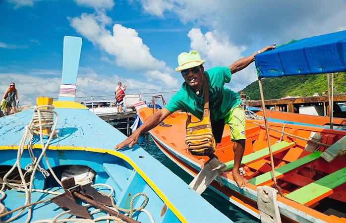 Take a scenic boat ride around the coast of Koh Tao