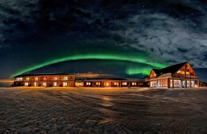 The Northern Lights span over the Hotel Rangá.